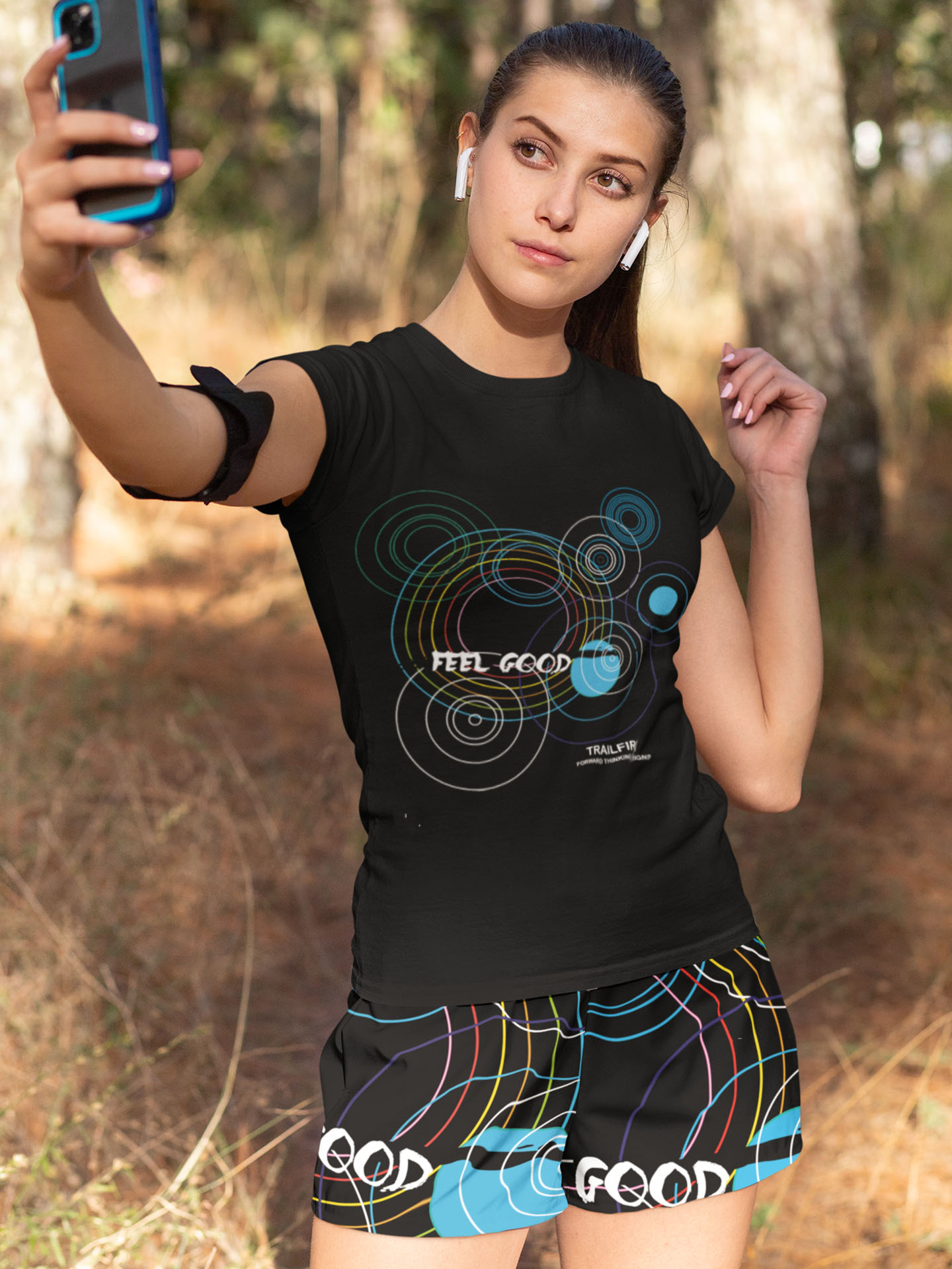 Spredshirt-Prints-Trailfire_0000_t-shirt-and-shorts-mockup-of-a-woman-taking-a-selfie-33080