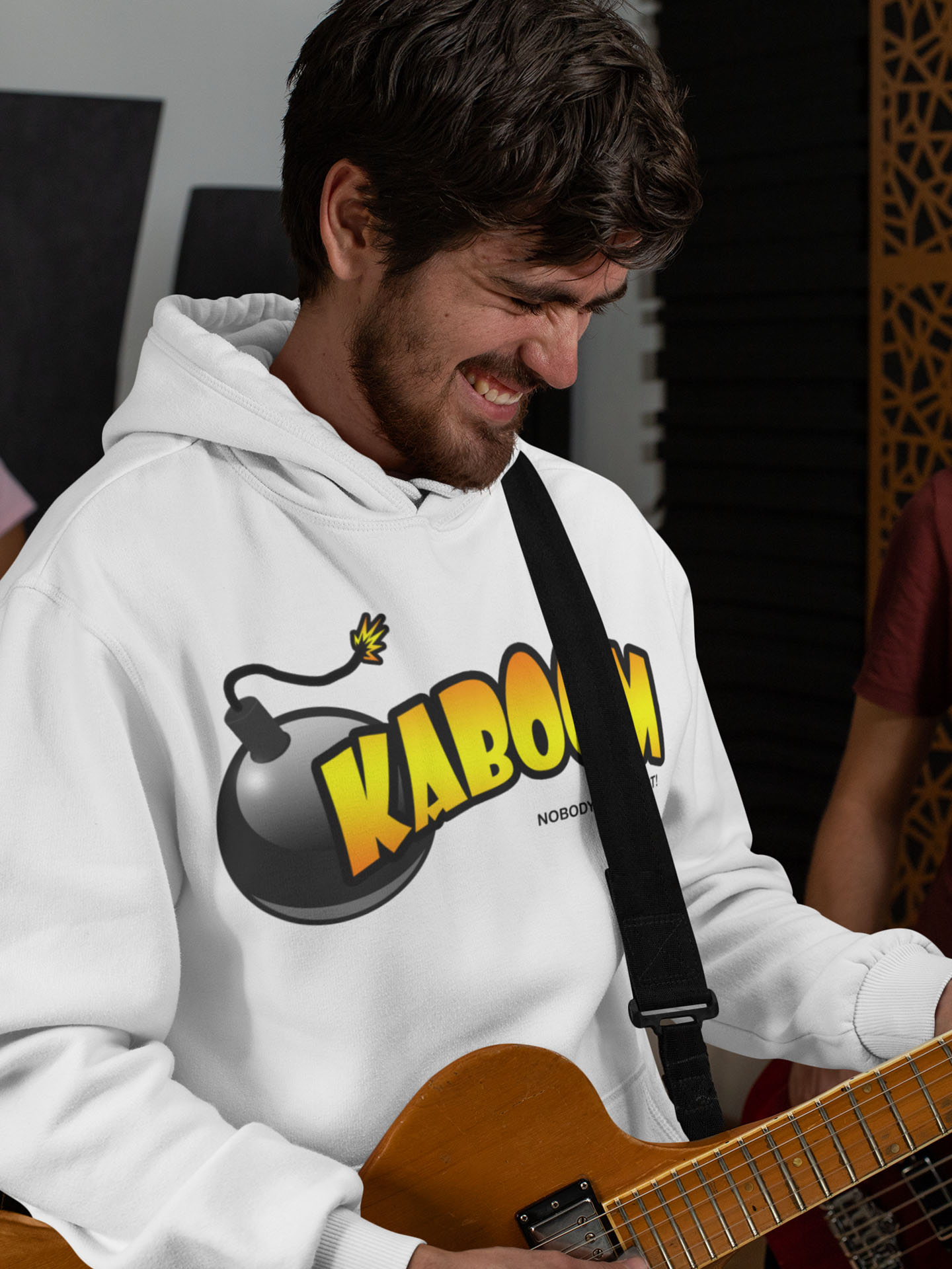 Spredshirt-Prints-Trailfire_0008_pullover-hoodie-mockup-of-a-bearded-man-playing-the-guitar-33340