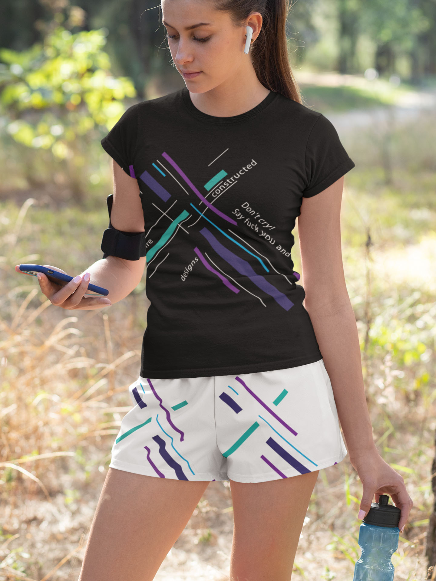 Spredshirt-Prints-Trailfire_0011_mockup-of-a-young-woman-wearing-a-sublimated-t-shirt-and-shorts-33079