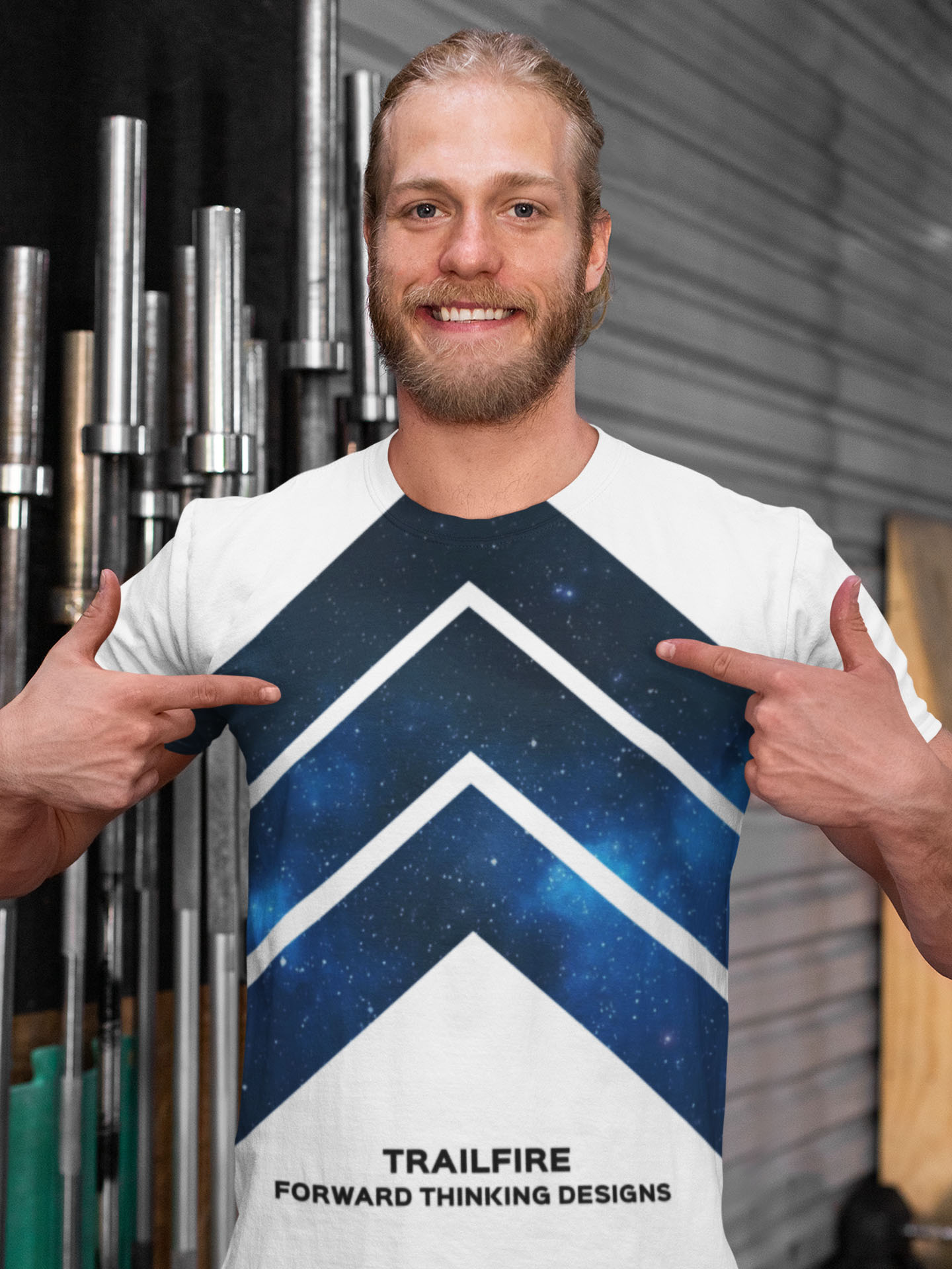 Spredshirt-Prints-Trailfire_0026_mockup-of-a-man-showing-his-sublimated-tee-in-front-of-the-bars-at-a-gym-33056 (1)