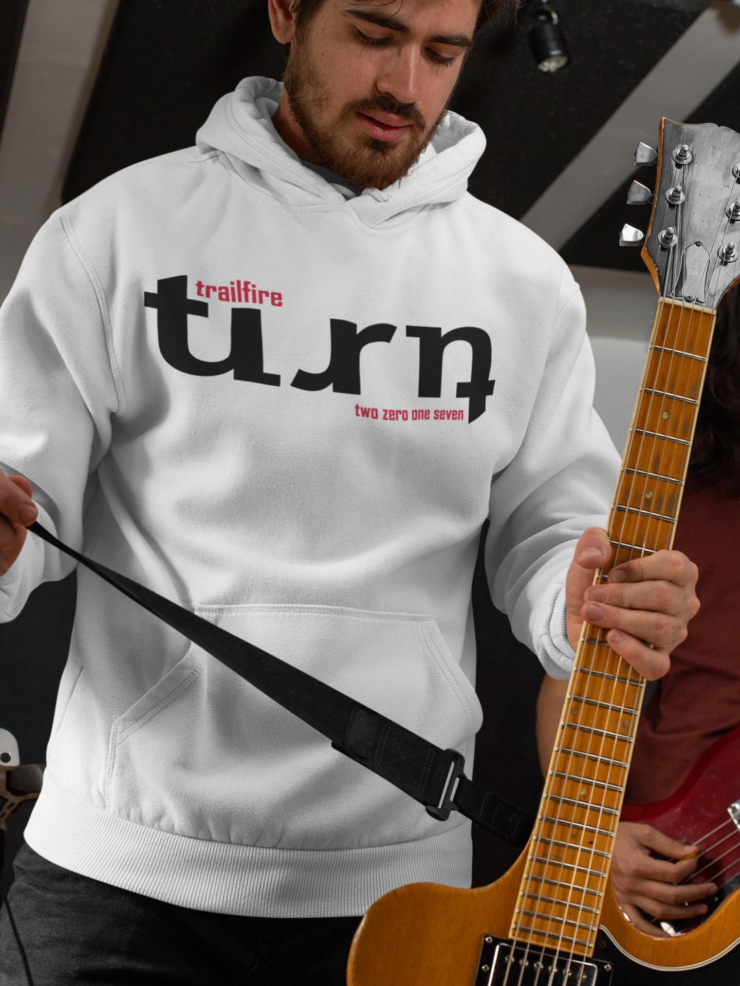 Spredshirt-Prints-Trailfire_0028_mockup-of-a-guitarist-wearing-a-pullover-hoodie-33337