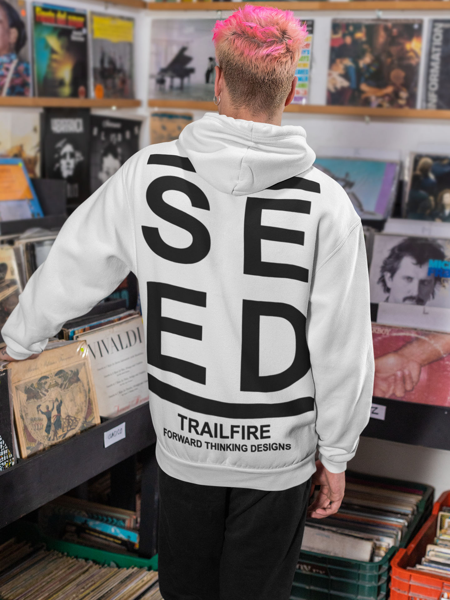 Spredshirt-Prints-Trailfire_0044_back-view-mockup-of-a-man-with-a-hoodie-looking-at-some-vinyl-records-33319