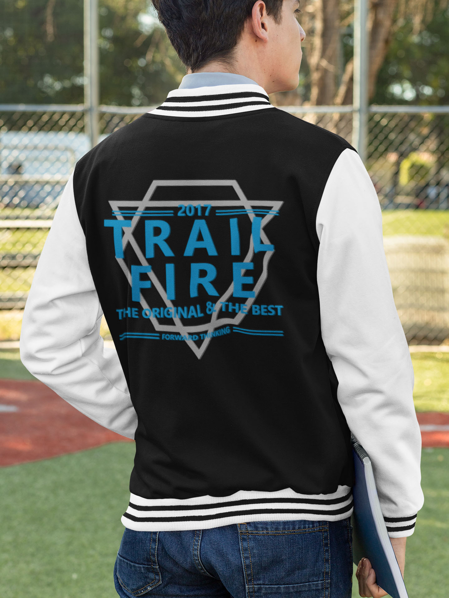 Spredshirt-Prints-Trailfire_0045_back-view-mockup-of-a-man-wearing-a-college-jacket-32203