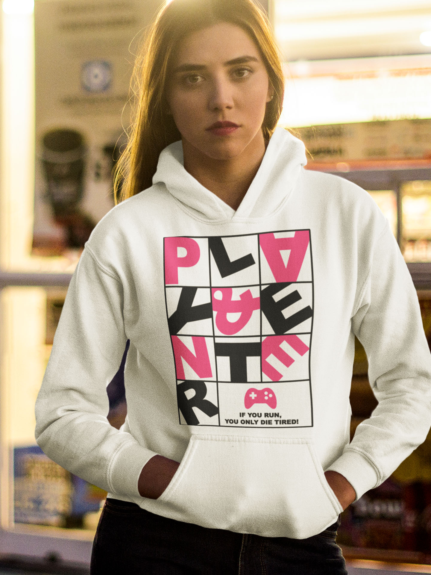 Spredshirt-Prints-Trailfire_0053_young-white-girl-wearing-a-pullover-hoodie-while-outside-of-the-supermarket-mockup-a135