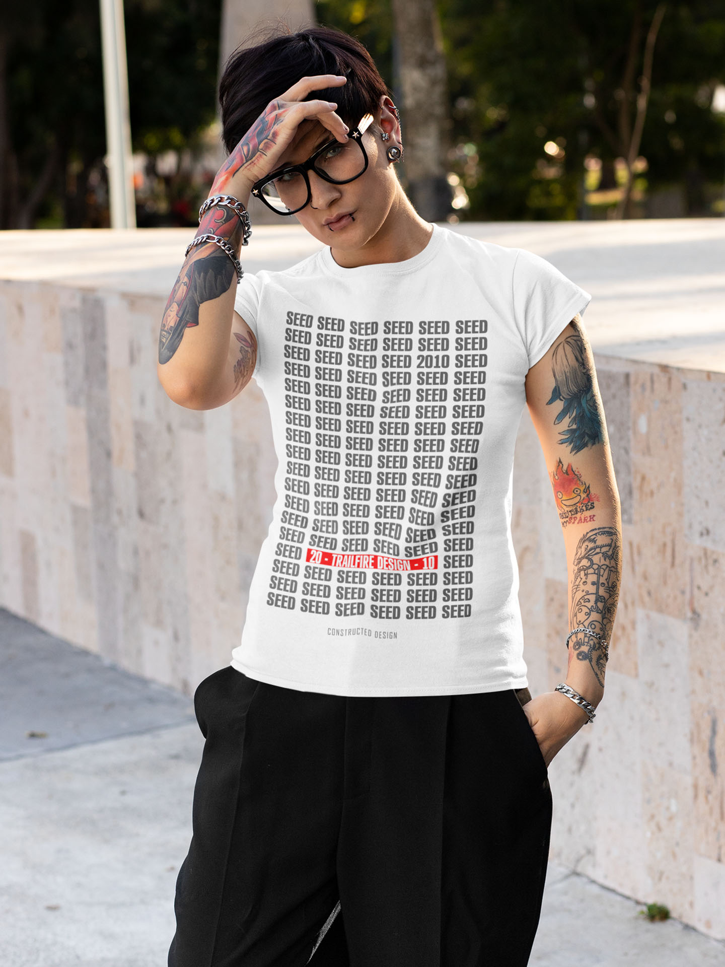 Spredshirt-Prints-Trailfire_0057_t-shirt-mockup-of-a-tattooed-woman-with-an-androgynous-style-32932